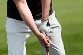 Man Golfs