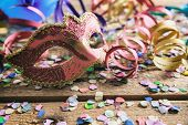 Carnival Party. Mask, Confetti And Serpentines On Wooden Background poster