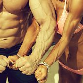 Sporty Couple Man And Woman Bodybuilders Show Strong Arms With Visible Veins Fists Muscular Physique poster