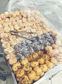 Thai Dessert Called Kai Hong With Ground Bean Wrapped With Power And Fried In Thailand Street Mark poster