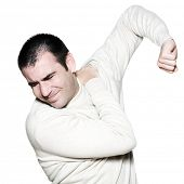 Portrait of a handsome expressive painful man holding shoulder on studio on white isolated backgroun