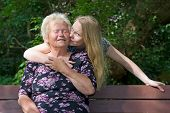 stock photo of oma  - Grandmother and Granddaughter in a park together - JPG