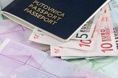 Euro Banknotes with Passport on Top