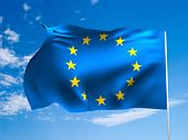 Flag of European  Union waving in the wind against a blue sky