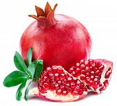 Ripe pomegranate fruits with pomegranate leaves on the white background. poster