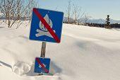 Funny signpost in snowdrift