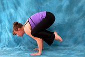 Left Side View Of Woman In Yoga Crow Pose