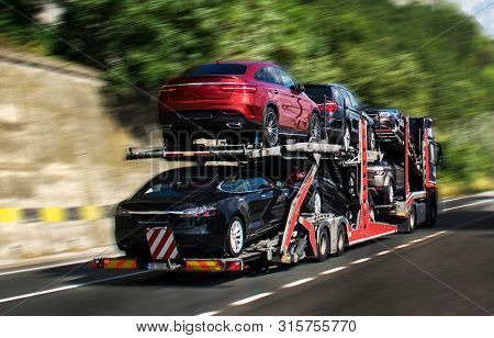poster of A Car Carrier Trailer, Known Variously As A Car-carrying Trailer, Car Hauler, Auto Transport Trailer
