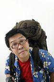 Tired Asian Backpacker