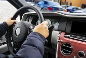 Male Hands Holding Car Steering Wheel. Hands On Steering Wheel Of A Car Driving. Young Man Driving A poster