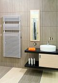 stock photo of lavabo  - Bathroom with round basin and towels heater - JPG
