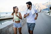 Happy Fit People Running And Jogging Together In Summer Sunny Nature poster