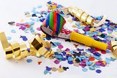 noisemaker and party confetti
