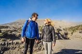 Young Couple Man And Woman Visit The Bromo Volcano At The Tengger Semeru National Park On The Java I poster