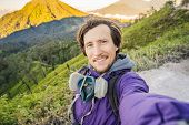 Young Man Tourist Makes A Selfie With The Magnificent Views On Green Mountains From A Mountain Road  poster