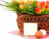 Banner add with Easter eggs and spring flowers in basket