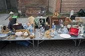 foto of peddlers  - Detail of a stallholder with old artworks in the street  - JPG