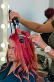 Hairdresser Makes Hairstyle To Client Using Curling Iron. Hairdressing Services. Girl With Colorful  poster