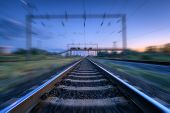 Railroad And Blue Sunset Sky With Clouds With Motion Blur Effect. Industrial Landscape With Railway  poster