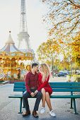 Romantic Couple In Love Near The Eiffel Tower In Paris, France poster