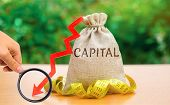 Money Bag With The Word Capital And Arrow Down. Fall In The Level Of Authorized Capital. Drop In Ret poster