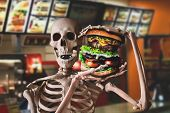 Funny Skeleton Eating Junk Food And Have Unhealthy Lifestyle poster