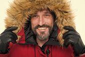 Winter Stylish Menswear. Man Bearded Hipster Wear Warm Jacket With Fur White Background. Guy Wear Wa poster