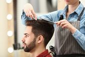 Barber Making Stylish Haircut With Professional Scissors In Beauty Salon poster