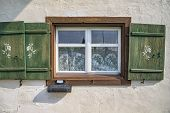 Old Ancient Wooden Window With Blinds, Curtains And Mailbox. Scenic Original And Colorful View Of An poster