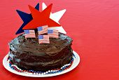 Chocolate fudge cake decorated for July 4, close up with copy space.