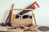 Old Wooden Tool Box Full Of Tools. Old Carpentry Tools. Still Life poster