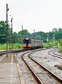 foto of railcar  - Diesel railcar is going to the next station - JPG