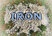 foto of ore lead  - Iron text in the rock ground  - JPG