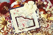 stock photo of heartwarming  - vintage wedding rings in handmade frame with dried flowers - JPG
