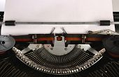 Typewriter With A Blank Sheet Of Paper