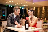 stock photo of diners  - Young couple on first date in romantic restaurant - JPG