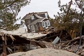 MANTOLOKING, NJ - JAN 13: A tilted house off its foundation on the beach on January 13, 2013 in Mant