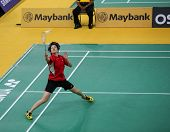 KUALA LUMPUR - JANUARY 15: Hong Kong's Cheung Ngan Yi returns the shuttlecock during her qualifier at the Maybank Malaysia Open 2013 Badminton event on January 15, 2013 in Kuala Lumpur, Malaysia.