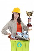 Female laborer holding gold cup
