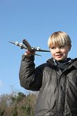 Little boy playing with toy plane