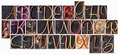 complete English alphabet  in ornamental script wood type - a  collage of 26 isolated letterpress pr