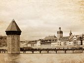 Panoramic view of Chapel Bridge, famous covered wooden bridge. Lucerne Switzerland - vintage style