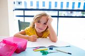 Child student kid girl bored with homework on desk table