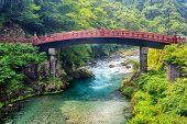 Red sacred bridge Shinkyo in UNESCO site of Nikko, Japan