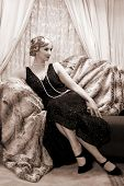 Reenactment of a vintage scene with a lady in the roaring twenties style