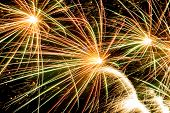 stock photo of salute  - Colorful bright fireworks over dark night sky - JPG