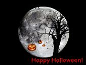 Happy Halloween composited image with a dead tree silhouetted against a full moon, jackolanterns, an