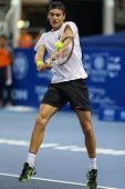 KUALA LUMPUR - SEPTEMBER 27: Joao Sousa plays a return to David Ferrer during a quarter-final match