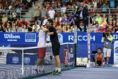 KUALA LUMPUR - SEPTEMBER 28: Joao Sousa (black) hugs Jurgen Melzer after winning this semi-final mat