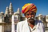 PUSHKAR, INDIA - DECEMBER 1: A Rajasthani man wearing traditional colorful turban posing after Pushk